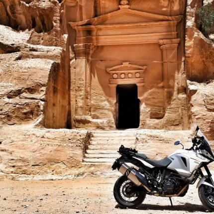 entrance to a sandstone building with bike outside