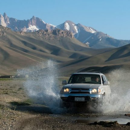 jeep driving through river in the bamiyan province