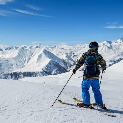 man skiing down georgian slopes