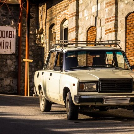 old car parked up near a mechanics on the silk road